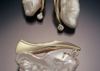 One of a kind earring and pin/pendant set.  Lusterous fresh water pearls and diamonds