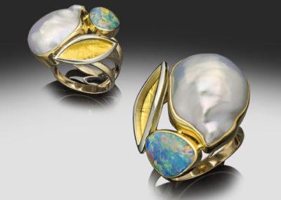 One of a kind yellow and white gold ring with a lusterous fresh water pearl, firey Australian opal